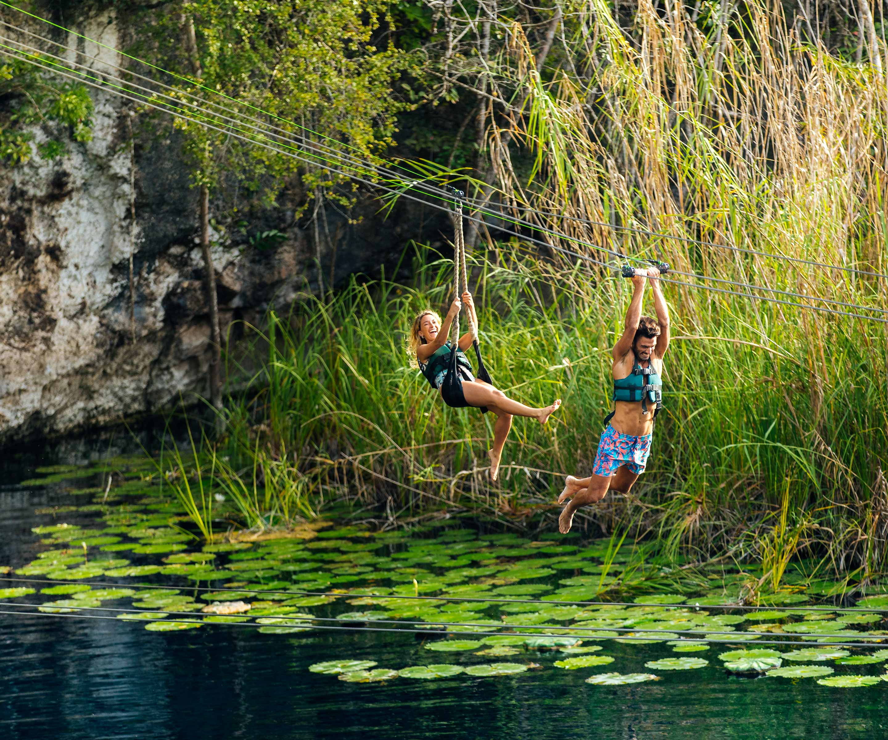 Enjoy the ziplines at the Iik cenote